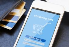 Mobile with shopping trolley and bank cards shutterstock_265411373 725 x 500.jpg
