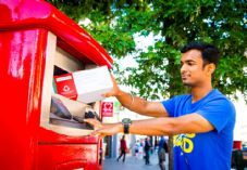 Royal Mail parcel postbox and man 725 x 500.jpg