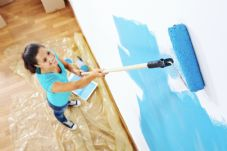 Woman painting blue paint