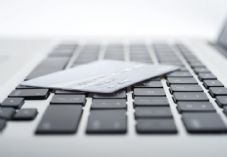 Laptop and card - NCR - shutterstock_116422102 725 x 500.jpg