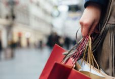 Female shopper carrying bags shutterstock_357891440 725 x 500